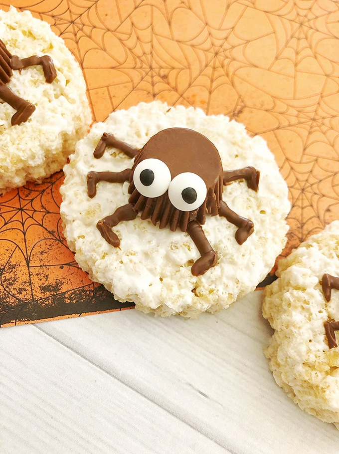 rice krispies treat decorated with spider peanut butter cups
