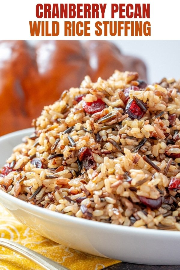wild rice stuffing with cranberries and pecans in a white serving bowl