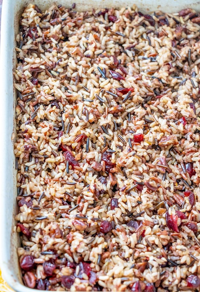 Cranberry Wild Rice Stuffing Casserole  in a white casserole dish