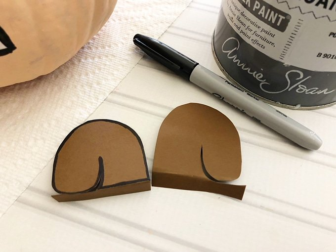 cut out cardstock paper to make squirrel ears for scaredy squirrel pumpkin craft