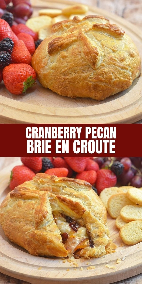 Cranberry Pecan Brie en Croute with assorted fresh fruits and toasted baguettes on wooden serving board