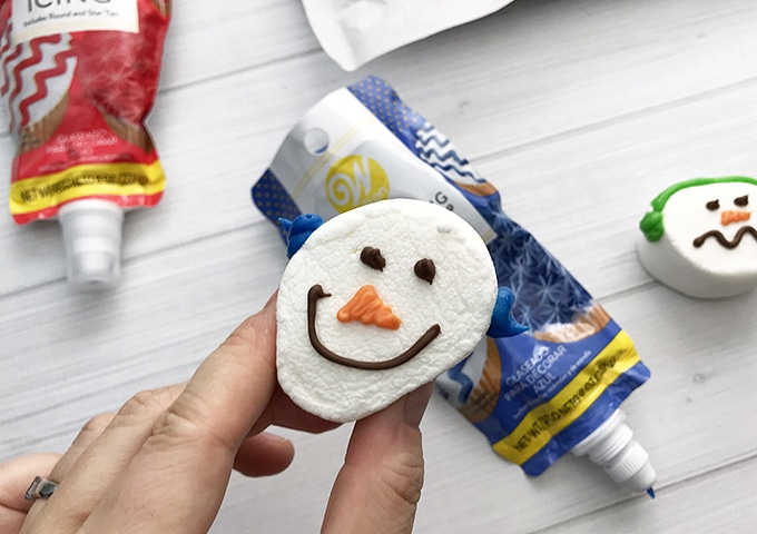 decorating jumbo marshmallows as snowman