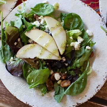 pear salad with dried cranberries, feta cheese and poppy seed dressing