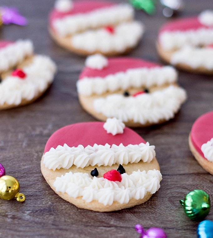 Santa cookies on a wooden board