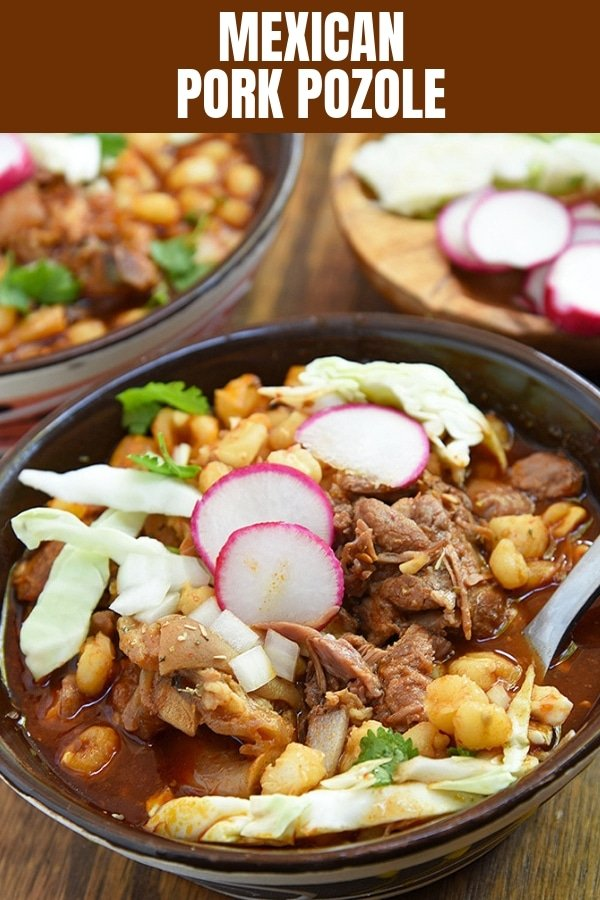 pork pozole with red sauce in a bowl