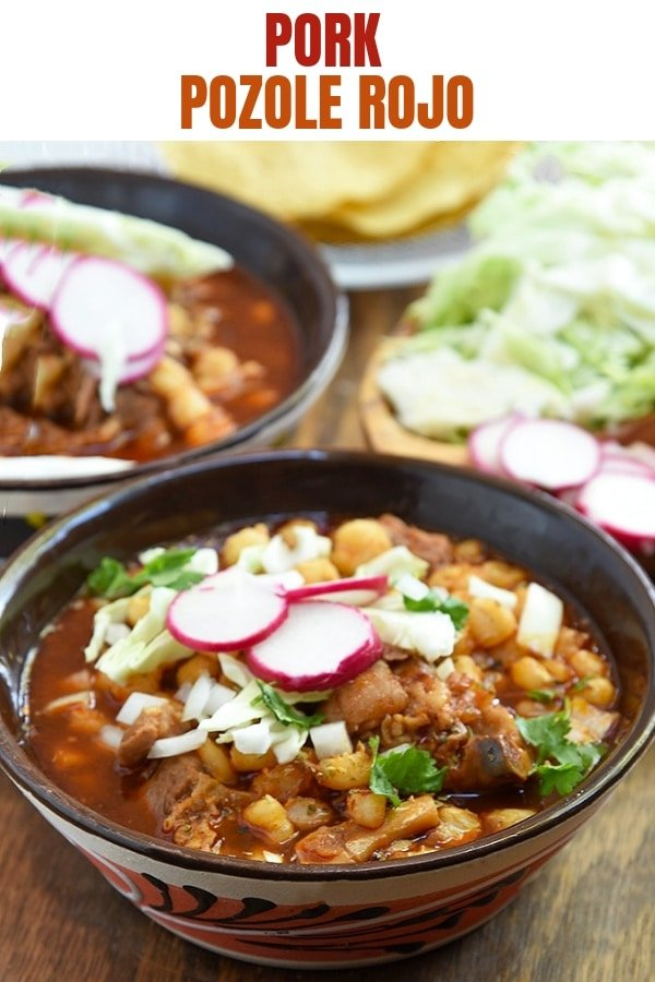 Mexican pozole in a bowl with cabbage, radish, onions, and cilantro
