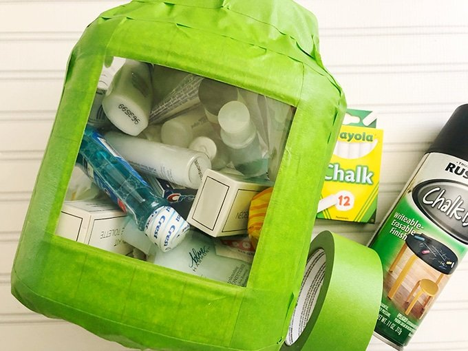 large jar filled with toiletries and covered with painter's tape