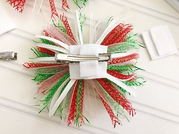 making Christmas hair bows with holiday gift bows, felt, and alligator clips