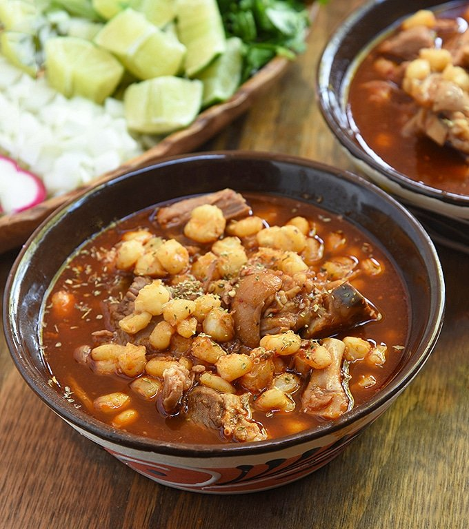 Authentic Pozole Rojo with pork with red chile broth in a large bowl