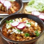 Pork Pozole Rojo with radish, cabbage,and onions in a bowl