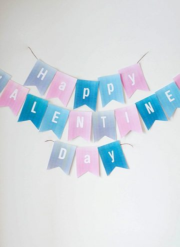 wall decorated with Valentine's Day garland