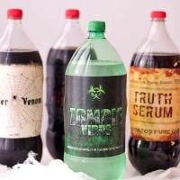 assorted soda bottles with halloween labels