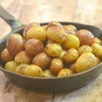 pressure cooker roasted potatoes in a white dish