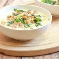 Olive Garden's Zuppa Toscana Copycat recipe you can easily make at home! Chock-full of spicy Italian sausage, tender potatoes, bacon bits, and kale leaves, it's hearty and delicious!