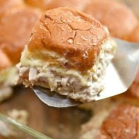 bacon ranch chicken sliders in a glass baking dish