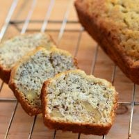 sliced mini banana bread loaves on a baking rack